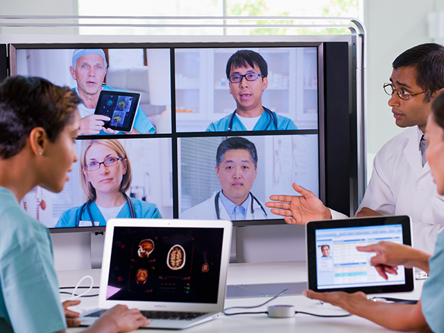 medical professionals having a meeting over digital conferencing technology