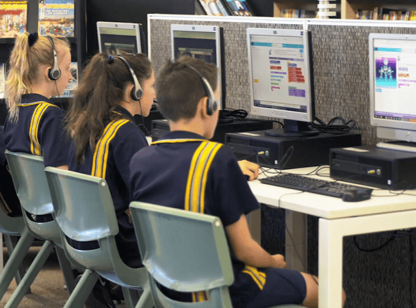 children learning at school on computers