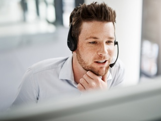 man working at support desk