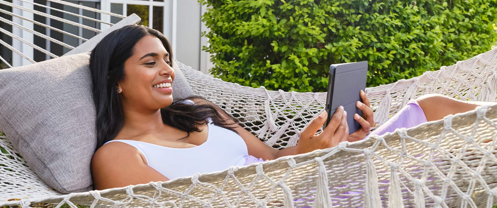 Woman on her tablet enjoying fast speeds on nbn