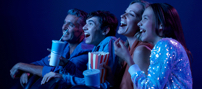 People enjoying a movie bought through Telstra Plus