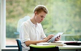 Boy reading on eReader device